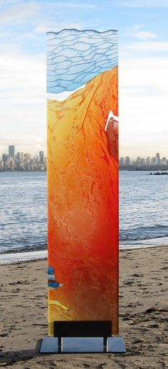 """Orange and Blue Monolith"" by Markian Olynyk.  20"" x 16"" x 75"".  Glass, paint, powder-coated steel."