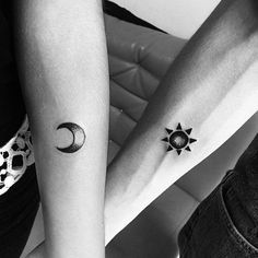 Micro couple tattoos. The tattoos show a sun and moon on both hands signifying that where one partner is the sun, the other is the moon. Both work in perfect balance with each other.
