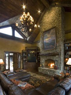 Log Home Designs | Rustic Home Designs | Timber Framed Homes ~ love the fireplace with the stone going all the way to the ceiling.