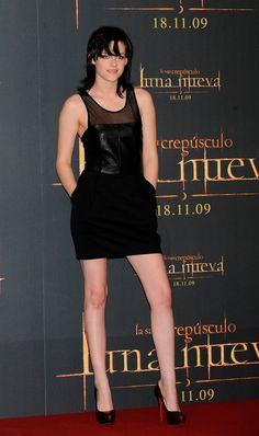 Pin for Later: Kristen Stewart's Red Carpet Evolution Proves She's a Total Fashion Girl  The actress opted for a sexy leather minidress by Elizabeth and James while promoting New Moon in Madrid in 2009.