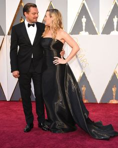 Pin for Later: Leonardo DiCaprio Had the Time of His Life at the Oscars Leo Shared a Sweet Moment With Kate Winslet on the Red Carpet