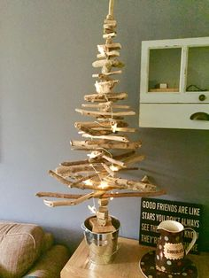 Drift wood Christmas tree. Drift wood threaded on to a metal rod. I'd use a thicker rod next time to make it sturdier.
