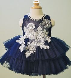Embroidered Tiered Dress--Made To Order - High Quality Paillette & Floral Embroidered Applique Pearl Round Neckline Sleeveless Knee Length Baby Infant Toddler Little Girl Tiered Layered Dress. Perfect Dress for your little flower girl. Available from 9 months - 7 years. Material: Tulle mesh, cotton, soft polyester fabric. Color: Navy Blue. We do not have a specific size for this dress, please leave us a note your little girl's height, bust and waist measurements so we can process it and send…