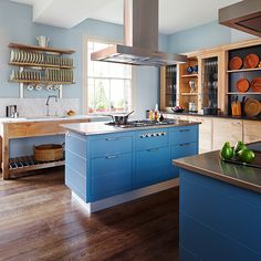 Kitchens: Traditional Kitchen with Blue Island also Wall Mount Dishes Shelf plus Over Island Range Hood and Wood Look Dishes