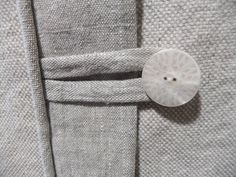 For this slipcover I put a linen flap over a concealed zipper and added button tabs. Check out the button texture...so pretty!