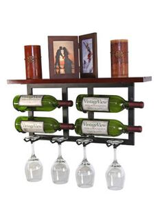 VintageView Vinolet at WineRacks.com for $39.95.  This rack hangs on your wall and holds 4 wine bottles and 4 glassware and has a shelf on the top for display or additional storage.  The initial shipment of Vinolet racks does not meet the usual quality control standards of VintageView and so they are offering these as factory seconds.