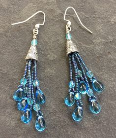 A personal favorite from my Etsy shop https://www.etsy.com/listing/502677770/dangle-drop-seed-bead-earrings-in