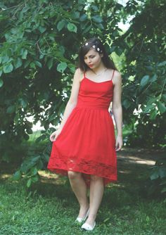 red, high low, lace dress with a dainty floral crown for some whimsy.   http://someonelikeyou18.blogspot.com/