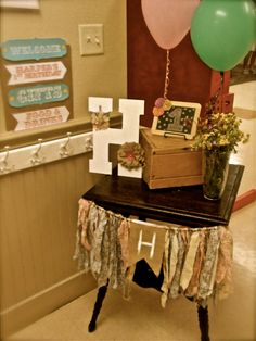 County Fair themed 1st birthday party.  Fabric banner: fabric purchased at Walmart, burlap penner from Hobby Lobby.  H: bought at Hobby Lobby. Painted white then tied fabric and burlap flower.  Chalkboard: from Hobby Lobby, hot glued scrapbook rosette flowers from Hobby Lobby.
