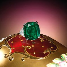 24.13-Carat Natural Untreated Colombian Muzo Emerald and Diamond Ring. Estimate : HK$ 10,000,000 – 15,000,000 (US$ 1,280,000 – 1,920,000). Centring on a cushion-shaped emerald weighing 24.13 carats, flanked by half-moon shaped diamonds together weighing approximately 2.30 carats respectively, mounted in platinum. Ring size: 5¾