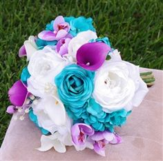 Specialty Teal Turquoise Peonies, Ranunculus and Purple Callas and Orchids…