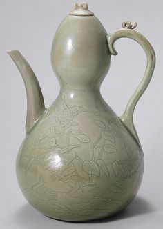 Wine ewer, Goryeo dynasty (918–1392), early 12th century  Korea  Stoneware with incised and carved decoration of geese, waterbirds, and Reeds under celadon glaze    H. 10 1/2 in. (26.6 cm)  Fletcher Fund, 1927 (27.119.2)