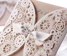 Lace Style Invitations.  Just think....burlap and rope added....too cute!