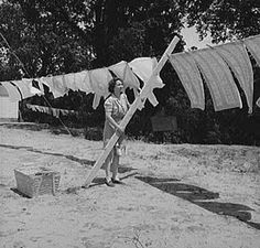 Hanging clothes out on the line..I remember well! How stiff things were, but oh, how good they smelled!