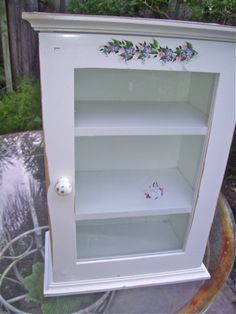 The Polka Dot Closet: A Stool, Storage Box, And Curio Cabinet in the Store Window