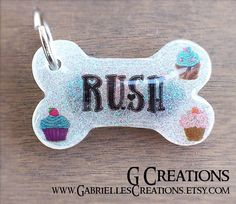 Items similar to Cupcake Bone Dog Tag - Glow in the DARK - Personalized Custom Handmade Dog Pet ID - Resin Girlie Cupcakes - Cute Dog Collar Accessory on Etsy Cute Dog Tags, Dog Id Tags, Pet Tags, Cute Dogs, Cute Dog Collars, Bottle Jewelry, Pet Id, Clay Design, Dog Accessories