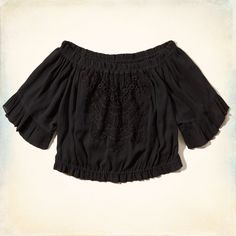 Girls Off-the-Shoulder Peasant Top | Feminine Boho blouse with an easy silhouette, pretty all-over print pattern with an off-the-shoulder neckline and a comfortable cinched waist, finished with a lace piece at front and ruffles at sleeves, Easy Fit | HollisterCo.com
