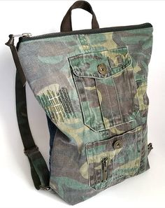 Mini camo and denim backpack. Made from repurposed camo pants and jeans :-) - upcycled camouflage fabric - upcycled denim - YKK zipper - leather zipper pull - upcycled fabric lining - inner pocket - adjustable straps up to 27(68.5cm) - 10 1/2(26.6cm) x 14(35.5cm) Please read shop policies