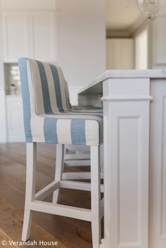 Verandah House Interiors: A Recent Project [May 16 (I like the beachy blue and white cabana-stripe bar-stool slipcovers.) chairs for island Kitchen Stools, Bar Stools, Bar Chairs, Dining Chairs, Kitchen Redo, Ikea Chairs, Design Kitchen, Room Chairs, Kitchen Ideas