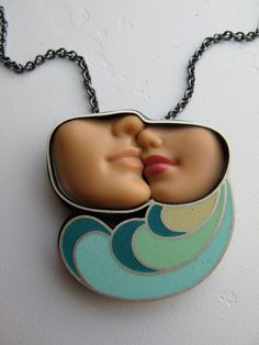 Now, this is inspired.  I wish I could do work like this. Swimmingly Necklace. $325.00, via Etsy.