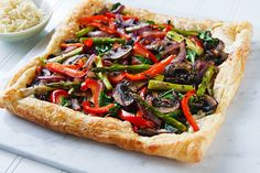 This spring vegetable tart looks like a work of art. Puff pastry isn't the healthiest item, but for special occasions, it makes veggies fun and festive.