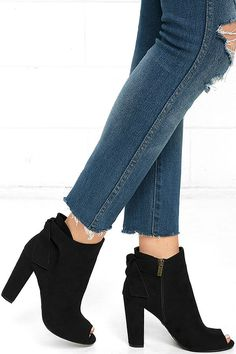 """Prepare yourself for all the compliments you are about to receive in the Ready to Stun Black Suede Peep-Toe Booties! Ultra soft vegan suede is sculpted to a peep-toe upper and ankle-high bootie with 5"""" zipper at the instep, and knotted back accent."""