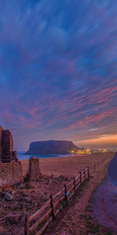 Beautiful isolation.  Sunset over The Nut, in Stanley - by Paul Pichugins