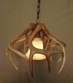 Real Whitetail Antler Pendant Light. $239.40, via Etsy.