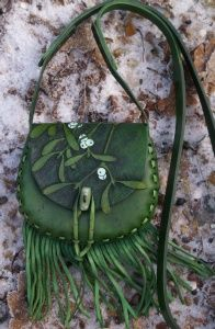 small green lavishly   hand carved mistletoe bag with fringing and ceramic toggle
