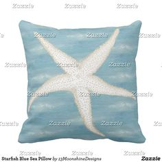 Starfish Blue Sea Pillow A vintage image of a starfish in white and cream beige is set on a background of soft ocean blue and faint sea green water and waves to make this lovely beach themed throw pillow.