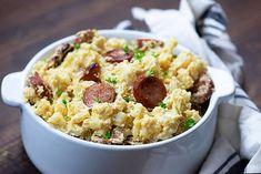 smoked sausage and cheesy potatoes in white dish