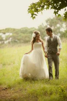 Wedding pictures in a field. Must have... like the suit with the rolled up sleeves...