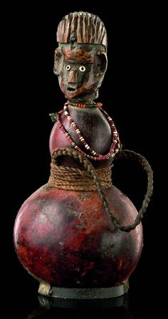 Africa | Diviner's calabash with figural stopper from the Zaramo people of Tanzania | Gourd/calabash, glass beads, string, wood