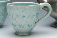 Kristin Kieffer Coffee cup (stamped), Victorian modern, Handmade in pale turquoise Frost w. Sky blue detail. $60.00, via Etsy.