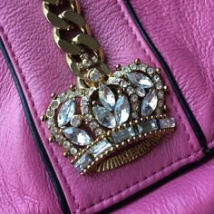 SALENWT Genuine leather fuscia evening bag. NWT Genuine leather small fuscia evening bag with gold and rhinestone crown. Pristine condition!Gorgeous!Even prettier in person!! Wilsons leather Bags