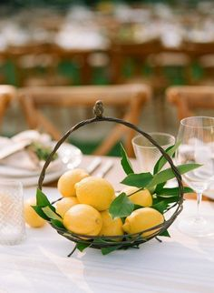 Fruit wedding centerpiece - lemons in a basket Rue 29 Napa Valley Lemon Centerpieces, Unique Centerpieces, Wedding Table Centerpieces, Wedding Flower Arrangements, Wedding Decorations, Centerpiece Flowers, Lemon Centerpiece Wedding, Fruit Centerpiece Ideas, Italian Centerpieces