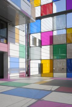 daniel buren adds tinted squares to colorize  and unite the existing architecture of france's strasbourg modern and contemporary art museum