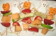 "Healthy Halloween Fruit Kabobs - Trick or treat -- give me something good to eat! Decorated fruit kabobs are a festive way to add something healthy to your Halloween spread! A super simply easy Halloween recipe for classroom or kids parties!"" data-componentType=""MODAL_PIN"