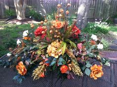 Pretty fall colors in this large versatile silk floral arrangement. Can be used as a table centerpiece, place above a hutch. By Greatwood Floral Designs www.greatwoodfloraldesigns.com