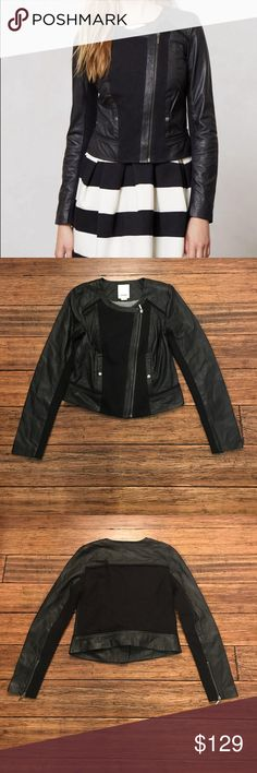 """NWOT Black Leather Collarless Mixed Moto Jacket NWOT. Endlessly versatile and totally timeless, the moto jacket is a wardrobe staple on par with your perfectly broken-in jeans and undisputed go-to boots. It's a natural with denim, but don't hesitate to pair it with a flouncy frock, either. Side pockets. Zip front. Approx. 20.5"""" long in front, 19"""" long in back, 17.5"""" across bust, 16"""" across waist. Shell 1 100% leather. Shell 2 97% cotton, 3% spandex. Lining 1 68% cotton, 17% polyester, 15%…"""