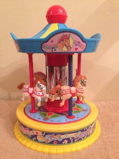 A personal favorite from my Etsy shop https://www.etsy.com/listing/469131876/1991-redbox-wind-up-carousel