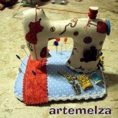 its not so much the pin cushion but the idea of decorating my sewing machine that I like