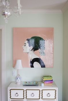 Matchbook Magazine - girl's rooms - watery green walls, audrey hepburn, audrey hepburn art, white chest, white and gold chest, dorothy draper-esque chest, dorothy draper style chest, melamine tray, white and pink lamp, pink face lamp, stacked books,