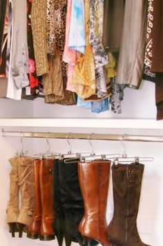 Use pant hangers to hang boots from...