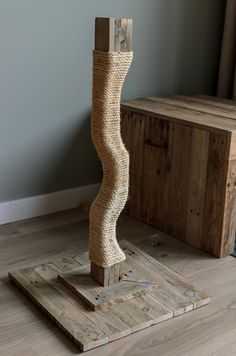 DIY cat scratching post made from pallet wood.