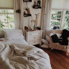 Cozy White Bohemian Bedroom: Styled by Urban Outfitters      Relaxing warm white bedroom     White bedroom: From Ikea....love that lampsha...