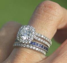 doing this: add a band with your husbands birthstone to your set. march is aquamarine... my something blue?