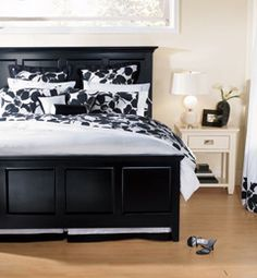 I like the bed frame.  We've talked about doing a black and white theme in our master.