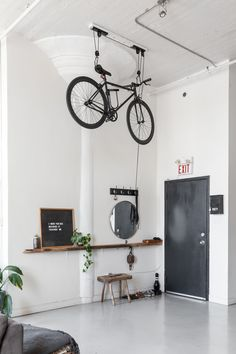 Nautical Scandinavian Style in a Bright White Toronto Loft This Toronto apartment's super high ceilings work perfectly for this one-of-a-king bike pulley sy Toronto Lofts, Toronto Apartment, Indoor Bike Storage, Bicycle Storage, Hanging Storage, Bike Storage For Small Spaces, Bike Storage Pulley System, Vertical Storage, Bike Storage Apartment