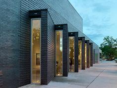 "Deborah Berke Partners — 21c Bentonville  The contrast between these brick wall segments which ""fan"" open like doors against the unbroken brick expanse above"